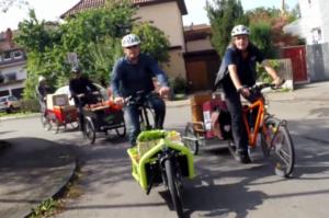 SWR-Fernsehbeitrag über Fahrt von Verkehsminister Winfried Hermann auf dem Lastenrad durch Stuttgart.